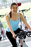 Woman doing spinning at the gym Royalty Free Stock Photo
