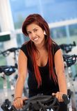 Woman doing spinning in a gym Stock Photography