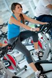 Woman doing spinning at the gym Stock Photography