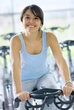 Woman doing spinning in a gym Royalty Free Stock Images