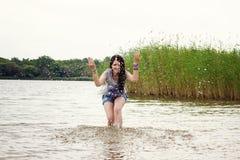 Woman doing splashes Stock Photo