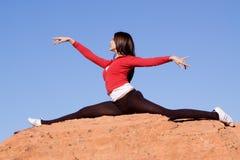 Woman doing split Stock Photo