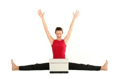 Woman doing split with laptop. Woman doing a split and using laptop Royalty Free Stock Image