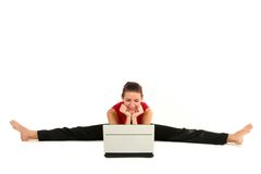 Woman doing split with laptop. Woman doing a split and using laptop Stock Photography