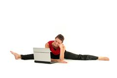 Woman doing split with laptop. Woman doing a split and using laptop Royalty Free Stock Photography