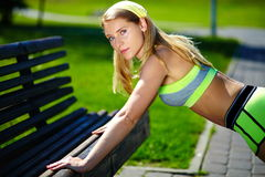 Woman doing sport exercise outdoors Royalty Free Stock Photos