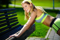 Woman doing sport exercise outdoors Stock Photo