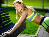 Woman doing sport exercise outdoors Stock Photography