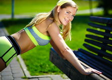 Woman doing sport exercise outdoors Royalty Free Stock Image
