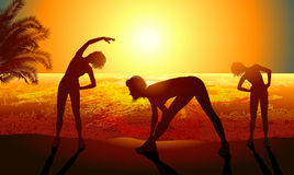 Woman doing sport exercises. Silhouettes of a woman doing sport exercises on the beach Royalty Free Stock Image