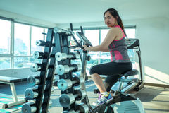 Woman doing sport in the gym for fitness Royalty Free Stock Images