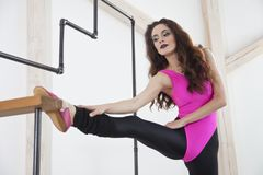 Woman doing sport. Stretching exercises - woman doing sport in studio Stock Photos