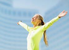 Woman doing sports outdoors Stock Photos