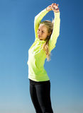 Woman doing sports outdoors Stock Photography