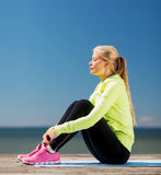 Woman doing sports outdoors Stock Photo