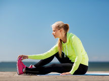 Woman doing sports outdoors Stock Images