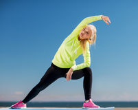 Woman doing sports outdoors Stock Image