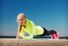 Woman doing sports outdoors. Sport and lifestyle concept - woman doing sports outdoors Stock Image