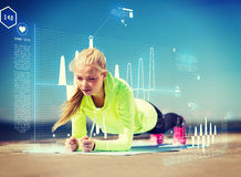 Woman doing sports outdoors. Sport and lifestyle concept - woman doing sports outdoors Stock Photo
