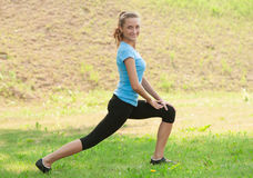Woman doing sports stretching exercise Stock Photo