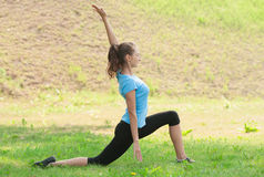 Woman doing sports stretching exercise Stock Images