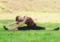 Woman doing sports stretching exercise Royalty Free Stock Image