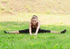 Woman doing sports stretching exercise Royalty Free Stock Images
