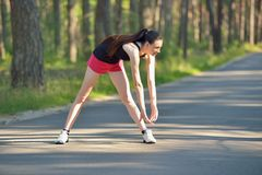 Woman doing sports stretching exercise Stock Image