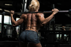 Woman Doing Squat Workout For Legs Royalty Free Stock Photography