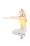 Woman doing squats Royalty Free Stock Photo