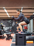 Woman doing squats on pnatfom in gym Royalty Free Stock Photo
