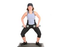 Woman doing squats on top of step Stock Photos