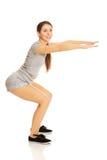 Woman doing squats Stock Photo