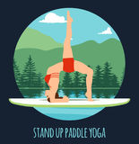 Woman doing Stand Up Paddling Yoga on Paddle Board on Water at lake Mountain landscape Stand Up Paddle Yoga Workout Royalty Free Stock Photo