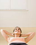 Woman doing stomach crunches Royalty Free Stock Photography