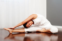 Woman doing stretch exercise Royalty Free Stock Photos