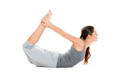 Woman doing stretch exercise in grey clothes Royalty Free Stock Photos