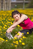 Woman doing stretch exercises stock image
