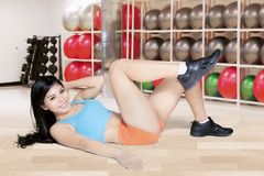 Woman doing a stretch in the fitness center Stock Image