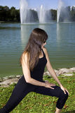 Woman doing a stretch in the park Stock Image