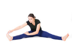 Woman doing stretches Royalty Free Stock Images
