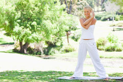 Woman doing stretches outdoors Stock Images