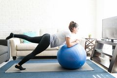 Woman doing stretching with ball stock photo