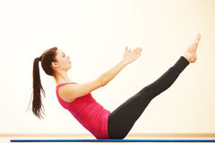 Woman doing stretching excercises in gym Stock Photography