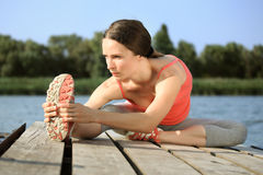 Woman doing stretching exercis. Active woman doing stretching exercise outdoors royalty free stock image