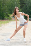 Woman doing stretching exercise Stock Photo