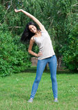 Woman doing stretching exercise Royalty Free Stock Photo
