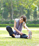 Woman doing stretching exercise Stock Photography