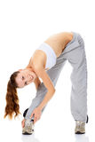Woman doing stretching exercise Stock Photos