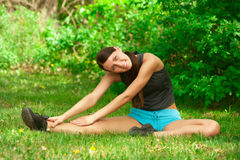 Woman doing stretching exercise Royalty Free Stock Photos